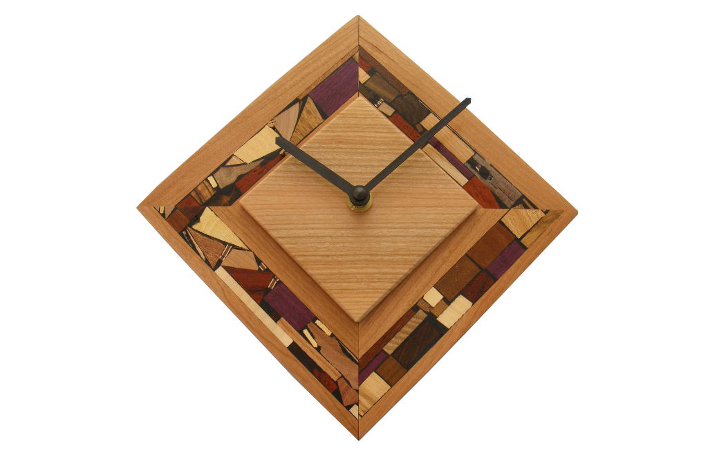 DIamond shaped clock cecorated w/ multi wood mosaics in their natural colors