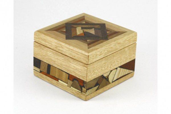Small wooden jewelry box adorned with multi wood mosaics. No stains or dyes.