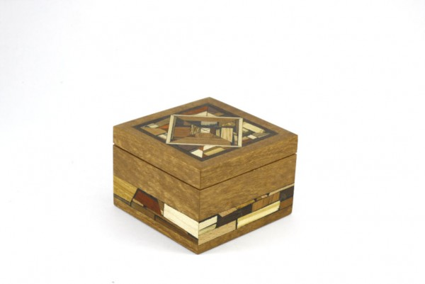 Small wooden keepsake box decorated w/ multi wood mosaics.