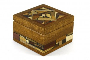 Small wooden box decorated with wood mosaics. No stains or dyes.